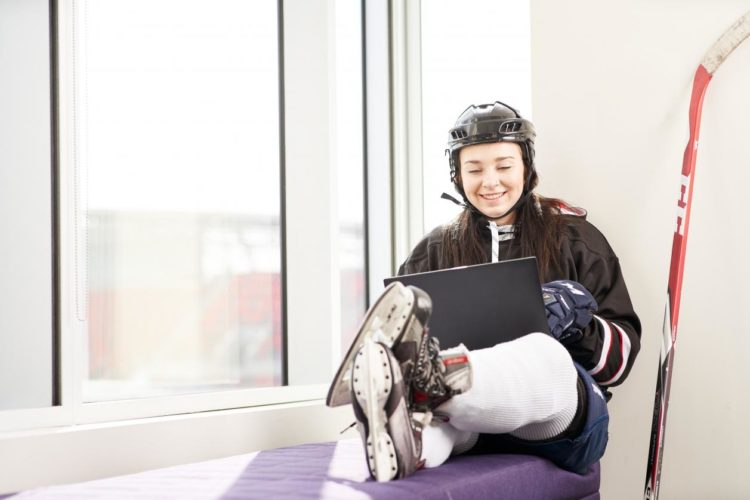 Work from home? Work from anywhere!   Hockey player reviews weekly reports Cassie smiled. The results were finally beginning to materialize. It was gratifying to see her hard work pay off.
